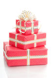 Wrapped gifts with a bow on a white background Stock Images