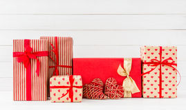 Wrapped gifts boxes and two red hearts on white  background. Copy space Royalty Free Stock Photo