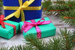 Wrapped gifts for Christmas and spruce branches on old plank Royalty Free Stock Image