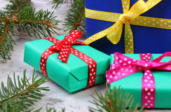 Wrapped gifts for Christmas and spruce branches on old plank Royalty Free Stock Photos