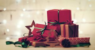 Wrapped gifts and decorations on flashing christmas lights background stock footage