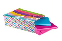 Wrapped gifts iin a colorful bag isolated on white Royalty Free Stock Images