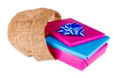 Wrapped gifts iin a jute bag isolated on white Stock Photo