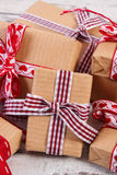 Wrapped gifts in recycled paper for Valentines or other celebration Royalty Free Stock Images