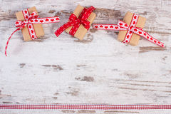 Wrapped gifts in recycled paper for Valentines or other celebration Royalty Free Stock Photo
