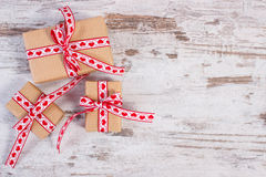 Wrapped gifts in recycled paper for Valentines or other celebration Stock Images