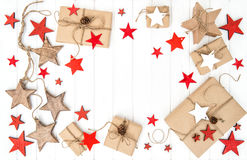 Wrapped gifts red stars decoration Flat lay Royalty Free Stock Photography