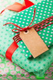 Wrapped gifts with tag Stock Photo