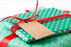 Wrapped gifts with tag Royalty Free Stock Photos