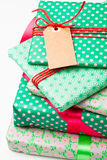 Wrapped gifts with tag Royalty Free Stock Images