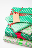 Wrapped gifts with tag Royalty Free Stock Photography