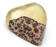 Isolated Heart Shaped Moldy Chocolate. Wrapped in golden foil, isolated on white background Stock Image