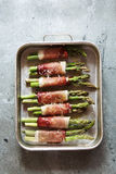 Wrapped ham asparagus on the tray before baking Stock Photos