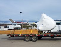 A wrapped helicopter being transported to alaska by road Stock Photography