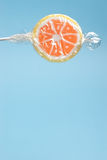 Wrapped orange lollipop Royalty Free Stock Images