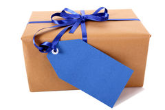 Wrapped package or parcel, blue gift tag or label, isolated on white Royalty Free Stock Photos