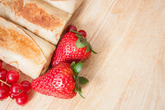 Wrapped pancakes with berries Royalty Free Stock Photos