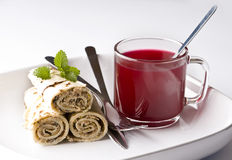 Wrapped pancakes and red borscht Stock Photo