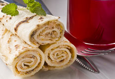 Wrapped pancakes and red borscht Stock Image