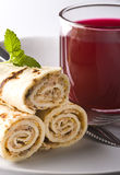 Wrapped pancakes and red borscht Stock Photography