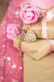 Wrapped in parchment paper, delicate fresh pink flowers with golden heart Royalty Free Stock Image