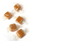 Wrapped pieces of fudge on a white background Stock Images