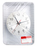 Wrapped plastic food container with clock. Wrapped plastic white food container with clock and blank label isolated Stock Photos