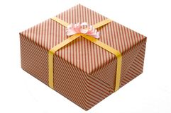 Wrapped Present. A single present wrapped in red and gold Stock Photo