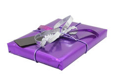Wrapped present. A wrapped present isolated on white, with clipping paths stock photography