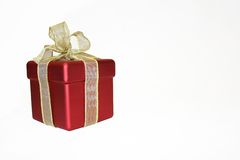 Wrapped present with bow. Wrapped present in red box with decorative bow, isolated on white background Stock Photos
