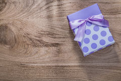Wrapped present box with tape on wooden board celebrations conce Stock Images