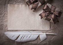 Wrapped present boxes sheet of wrapping paper plume celebration Royalty Free Stock Photo