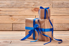 Wrapped present boxes on wood. stock image