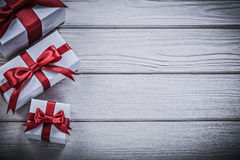 Wrapped present boxes on wooden board copyspace holidays concept Stock Photos