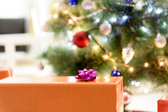 Wrapped present and Christmas tree Stock Image