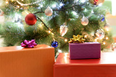 Wrapped present near Christmas tree Royalty Free Stock Image