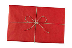 Wrapped present in red paper with string bow Royalty Free Stock Photos