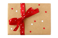 Wrapped present with red polka dots bow & confetti Stock Images