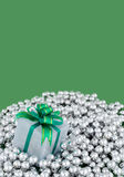 Wrapped present on silver pearls Stock Images