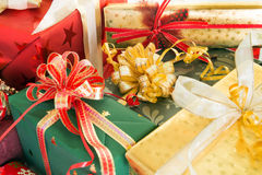 Wrapped presents. With colorful ribbons and feathers Royalty Free Stock Photography
