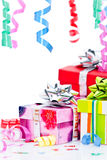 Wrapped presents and streamers Stock Photos