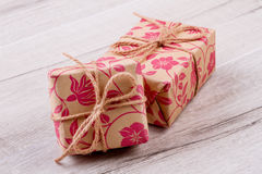 Wrapped presents on wooden surface. Royalty Free Stock Image