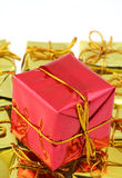 Wrapped red and gold presents Royalty Free Stock Images