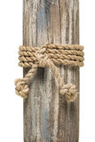 Wrapped rope on wood Stock Images