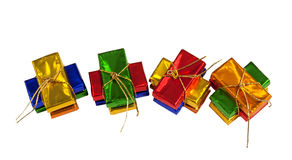 Wrapped sparkling little Chocolate Presents Stock Images