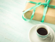 Wrapped surprise birthday holiday gift box and coffee Stock Image