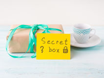 Wrapped surprise birthday holiday gift box and coffee Stock Images