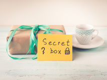 Wrapped surprise birthday holiday gift box and coffee Royalty Free Stock Image