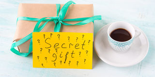 Wrapped surprise birthday holiday gift box and coffee Royalty Free Stock Photo