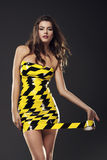 Wrapped in tape. Sexy woman wearing in dress from tape road Stock Photo